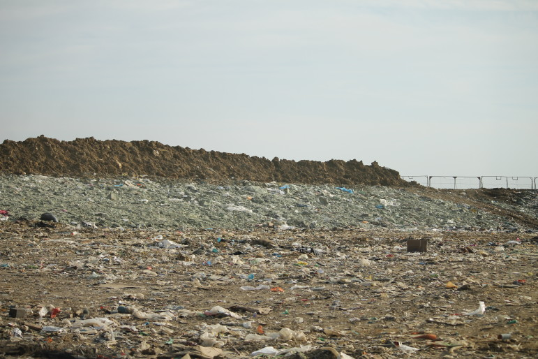 All waste disposed in the Metro Park East Landfill will be covered by greenish spray-on daily cover to protect public health and prevent blowing. (Sujin Kim/IowaWatch)