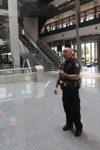 University of Iowa Police Officer Russell Shelangoski does a walk through of the Campus Recreation and Wellness Center in July 2013.