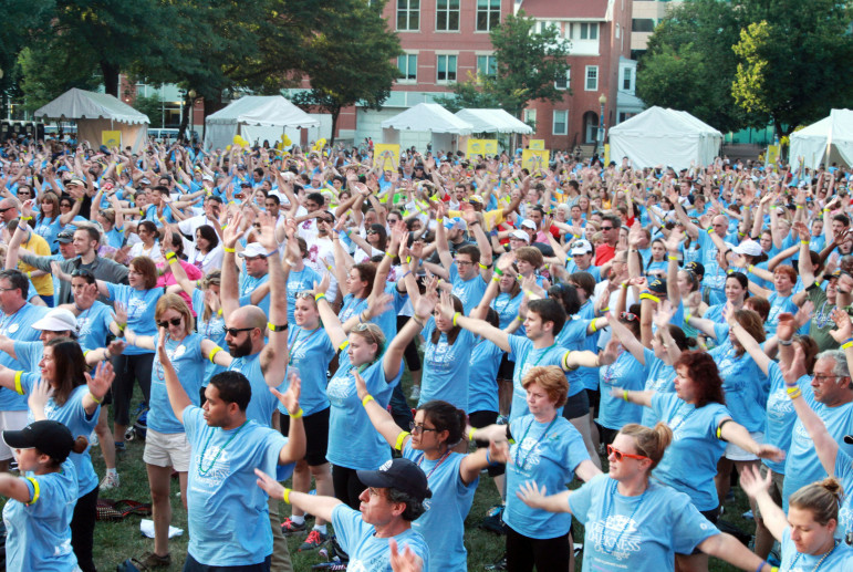 Walkers stretch to Zumba music before the Out of the Darkness Overnight Walk in Washington, D.C. June 1, 2013. The American Foundation for Suicide Prevention holds the annual walk to raise money for suicide awareness and prevention. About 2,000 walkers and volunteers participated this year.