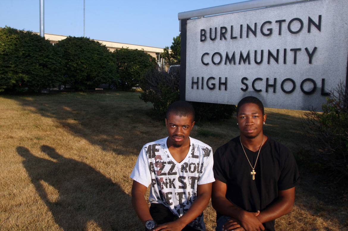Keith Davis, 17, and Orlando Johnson, 18, both seniors at Burlington High School, help mentor younger students at the school Tuesday Sept. 10, 2013 in Burlington, Iowa. They volunteer in the Iowa Disparity Project.