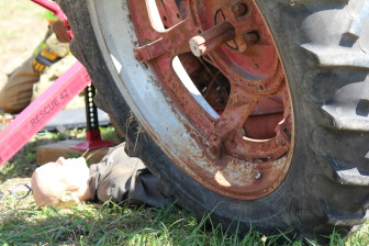 A dummy placed beneath a rolled over tractor gives Eastern Iowa firefighters a chance to practice their response in situations involving a farmer. This photo is from Tractor Roll Over Extrication Training put on by the Rural Health and Safety Clinic of Greater Johnson County on Aug. 3 at the Johnson County Extension Building in Iowa City.