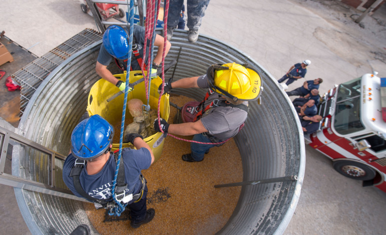 Firefighters practice placing a rescue tube during grain bin rescue training at the Danville, Ill., Bunge facility on Sept. 17.