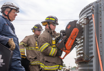 Firefighters learn how to cut grain relief slots during grain bin rescue training at the Danville, Ill., Bunge facility on Sept. 17.