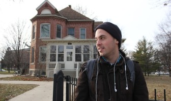 Art major Jordon Deutmeyer stands outside of the University of Northern Iowa Honors Cottage in December 2013.