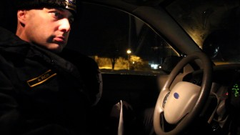 Iowa City Police Officer Derek Frank in his squad car in early March 2014.