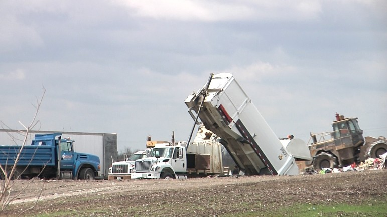 Trucks unloading garbage at the Cedar Rapids/Linn County Solid Waste Agency, where Marion, Iowa, takes its landfill waste.