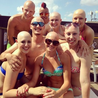 Taylor Goggin (front, center with sunglasses) and others from across the country with alopecia, during fun time in June 2014 at the National Alopecia Areata Foundation convention in San Antonio.