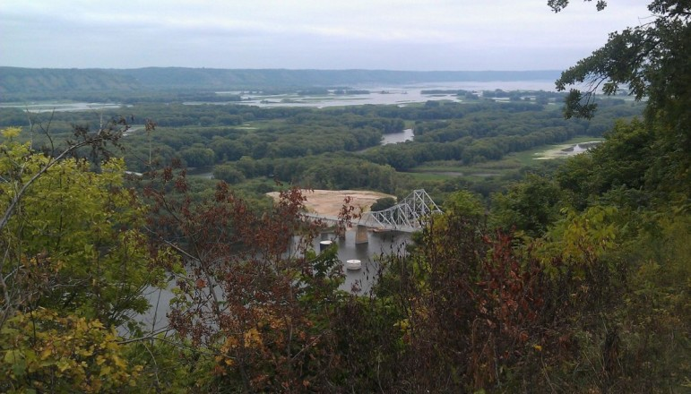 The Mississippi River bend, viewed from Mt. Hosmer City Park in Lansing, Iowa, provides one of several views that local residents say drive tourism to Allamakee County, in Iowa's northeast corner. Those residents fashioned a county ordinance that they believe effectively keeps large frac sand mines from being opened in the county.