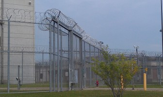 A mix of barbed wires and fencing is designed to maintain security at the Iowa Medical and Classification Center in Coralville.