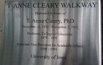 A sign marks the University of Iowa's T. Anne Cleary Walkway.