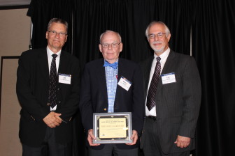 Michael Gartner (center) receives the 2014 Bill Monroe Free Press Champion Award (renamed Randy Brubaker Free Press Champion Award for 2015) at the annual IowaWatch Celebrating a Free Press and Open Government Banquet. Pictured with Gartner are (left) Bill Monroe and (right) IowaWatch executive director-editor Lyle Muller.