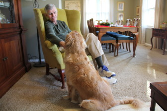 Frank Judisch, 78, pets his dog Zoe during a Dec. 6, 2014, interview in his Iowa City home.