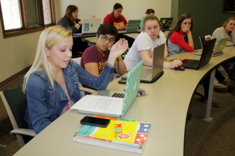 Aimee Loats, a sophomore biology major at Simpson College in Indianola who suffers from Crohn's disease, shares an assignment with the rest of a Communications 101 class on April 13, 2015. The class is an introduction to communications and media studies.