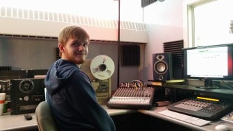 Buena Vista University junior Jacob Amhof in a vocal recording booth at school. He is seeking a vocal performance and music production double major while also dealing with autism.