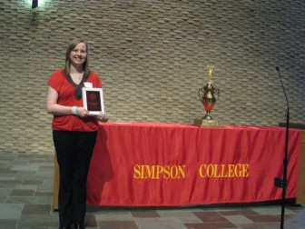 Katie Anthony, displaying her 'outstanding multimedia journalism  student 2012' award at Simpson College. Anthony, who has cyclic vomiting syndrome (CVS), is a graduate student at Iowa State University after earning her bachelor's degree at Simpson.