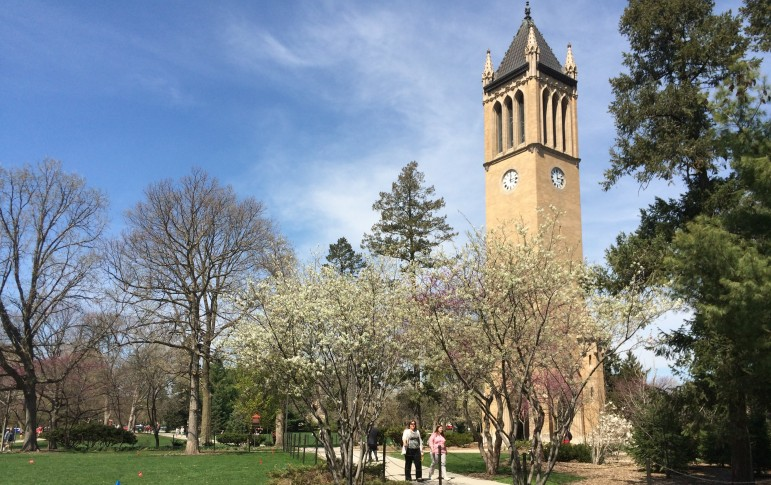 Students walk by the iconic Iowa State University Campanile tower on April 16, 2015.