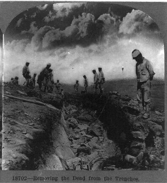 Removing the dead from the trenches in World War I.