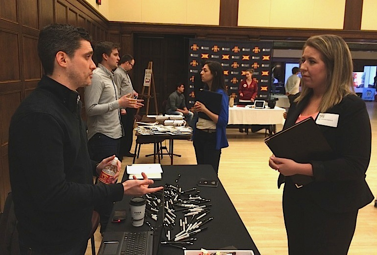 Taylor Tufte, an Iowa State University senior from Maple Grove, Minnesota, talks with a Bernstein-Rein job recruiter during a February 26, 2015, career fair for Iowa State journalism and communication students. Tuft says she fell in love with Iowa State after a visit to the school with a friend while in high school but doesn't want to stay in the state. She wants to live in a big city, she said.