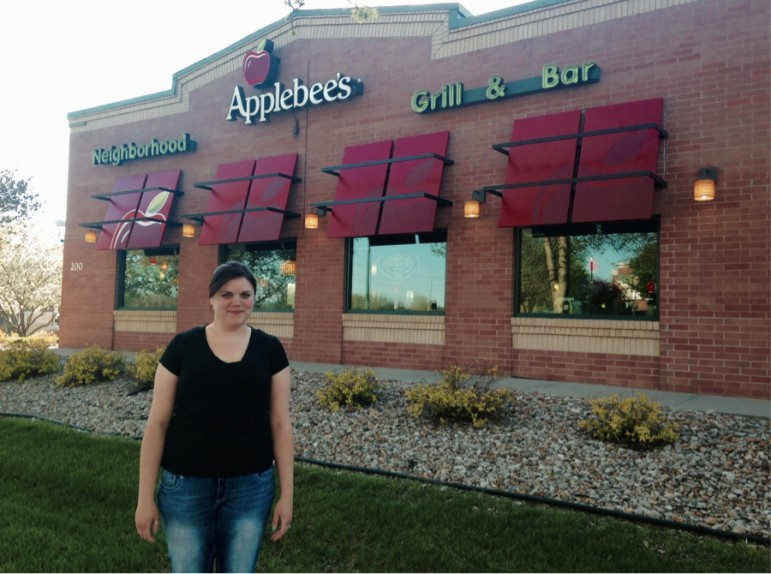 Katie Wilson outside the Coralville Applebee's where she won a wage theft claim. Photo taken April 27, 2015.