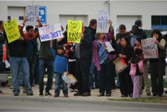 Protesters upset about unpaid wages gathered in front of the Outback Steakhouse in Cedar Rapids in May 2014.
