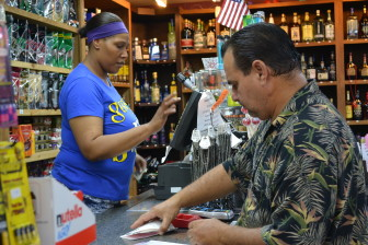 Customer Medardo Valdez, 50, won around $20 after purchasing a scratch ticket at Jim's Foods, 812 Sixth St. SW in Cedar Rapids, on July 27, 2015.
