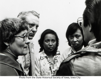 Seeing this Iowa Historical Society photo in an Iowa newspaper that published a Clare McCarthy IowaWatch story prompted Jeanne Buck Coburn to contact McCarthy. The picture shows Vietnamese refugees gathered in Des Moines in 1975 with Coburn's parents, Eleanor and Wayne Buck of rural Melbourne, Iowa, who helped the refugees resettle in the state.