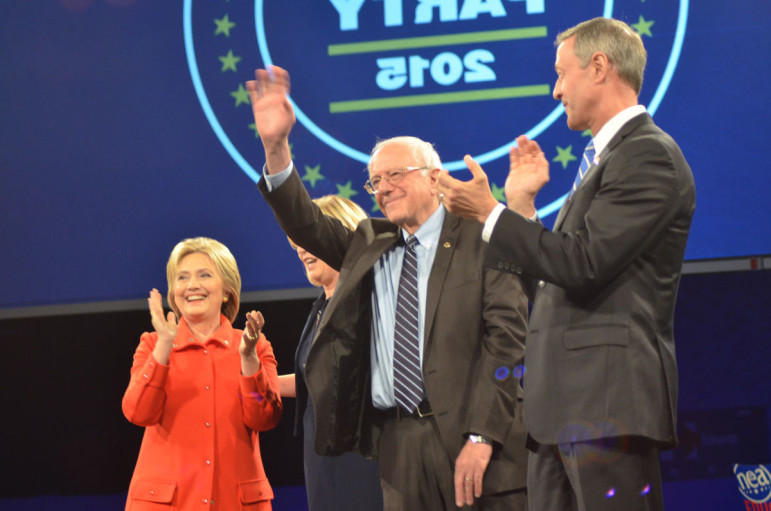 From left to right: Former Secretary of State Hillary Clinton, Vermont Sen. Bernie Sanders and former Maryland Gov. Martin O'Malley share the stage at the Iowa Democratic Party's annual Jefferson-Jackson Dinner in Des Moines on Saturday, Oct. 24, 2015.