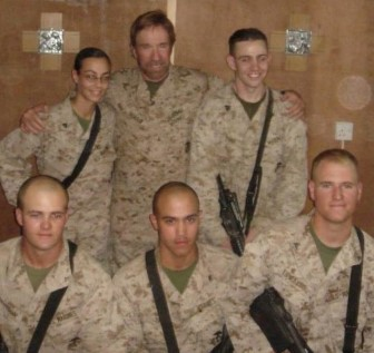 Actor Chuck Norris visited Logan Edward's unit while Edwards, seated lower left, was in the Marines in Iraq.