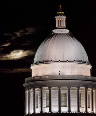 The September 27 supermoon lunar eclipse is shown behind the dome of the Arkansas State Capitol.