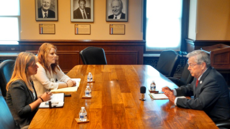 Iowa Gov. Terry Branstad in a July 7, 2015, interview with IowaWatch summer interns, left to the right, Makayla Tendall and Clare McCarthy.