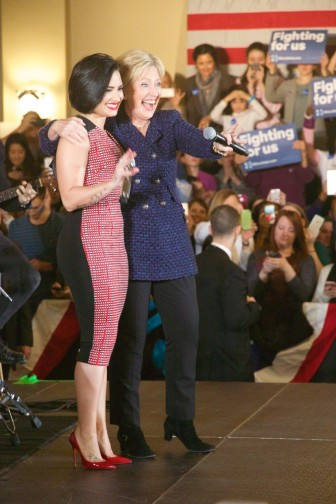 Pop singer Demi Lovato introduces Democratic presidential candidate Hillary Clinton to a large crowd at a campaign event for Clinton on Jan. 21, 2016, in the University Iowa's Iowa Memorial Union in Iowa City, Iowa.