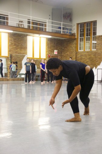 Brooke Robinson, a University of Iowa junior and member of the 2016 Dancers in Company troupe, practices during a Feb. 11 rehearsal. Robinson's performance was inspired by the experiences of her friends and family in her hometown of Flint, Michigan, where dangerously high lead levels were found in drinking water.