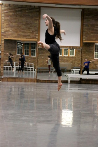 Julianna Feracota, a University of Iowa sophomore studying dance and accounting and member of the 2016 Dancers in Company troupe, gets some air during a Thursday, Feb. 11 rehearsal.