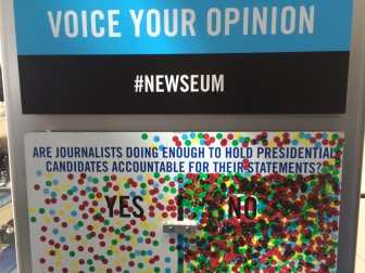 Visitors to the Newseum Institute in Washington, D.C., voice their opinion about whether or not journalists are doing enough to hold presidential candidates accountable when reporting their statements. The informal result when this photo was taken April 3, 2016, overwhelmingly was no.