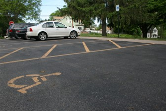 Markings and signage for a handicapped-accessible parking space and a loading zone outside a Cedar Rapids school on May 12, 2016.