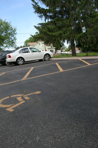 Markings and signage for a handicapped-accessible parking space and a loading zone are shown outside a Cedar Rapids school on May 12, 2016.