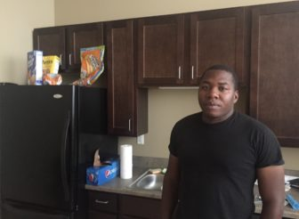 Marine Corps veteran Michael Washington in the kitchen of an apartment he was able to find in Davenport. Photo taken July 20, 2016.