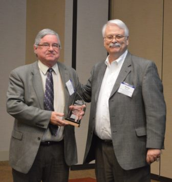 "Burlington Hawk Eye publisher and editor Steve Delaney receives his Harrison ""Skip"" Weber Friend of the First Amendment Award from Iowa Freedom of Information executive director Randy Evans."