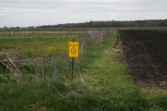 Signs, shown on April 29, 2016, sit on the four borders of Rob Faux's property outside of Tripoli, Iowa.