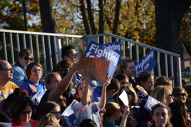 Two young girls show signs in support of Democrat Hillary Clinton during a Nov. 3, 2015, campaign stop in Coralville, Iowa.
