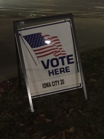 A Vote Here sign leads voters to a polling place in Iowa City on Nov. 8, 2016.